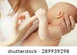 Closeup Hands  Mother Feeding...