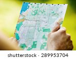 tourist reading a geographic... | Shutterstock . vector #289953704