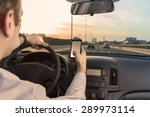 man using cell phone while... | Shutterstock . vector #289973114