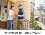 courier delivering a package to ... | Shutterstock . vector #289979600