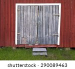 A Very Old Barn Door With A...
