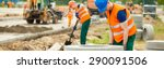 Construction worker is trying to move a kurb - stock photo
