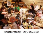 shoemakers working in a busy... | Shutterstock . vector #290152310