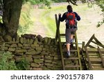 A Hiker Crossing A Stile On Th...
