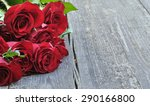 Stock photo red roses on wooden background 290166800