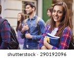 female student holding her books   Shutterstock . vector #290192096