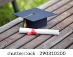Small photo of Black Graduation Cap with Degree