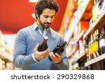 Man In A Supermarket Choosing ...