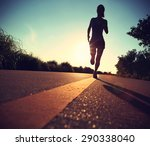 young fitness woman running on... | Shutterstock . vector #290338040
