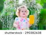 Little Girl Washing A Window....