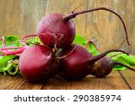 young raw organic red beets on...