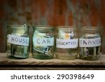 Glass Jars With Dollars And...