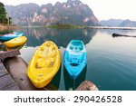 Yellow And Blue Canoe In A...