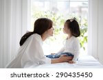 beautiful asian mom and her... | Shutterstock . vector #290435450