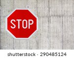 red stop sign on a concrete wall | Shutterstock . vector #290485124