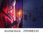 muslim woman holding candle in...   Shutterstock . vector #290488133