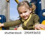 young girl on slide in... | Shutterstock . vector #290493653