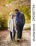 Couple Walking Along Autumn Path