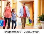 family walking through mall... | Shutterstock . vector #290605904