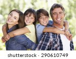 portrait of family in garden   Shutterstock . vector #290610749