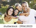 family relaxing in summer park | Shutterstock . vector #290613023