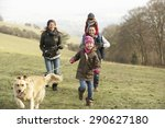 Stock photo family and dog on country walk in winter 290627180