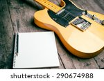 Telecaster With Notepad On Woo...