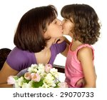 Happy Mother Kissing Her...