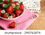 red ripe strawberries in bowl ... | Shutterstock . vector #290761874