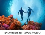 Freedivers Gliding Over The...