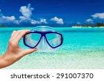 Hand Holding Snorkel Googles...