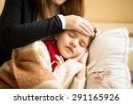 Closeup Photo Of Caring Mother...