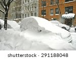 Snow Covered Cars In Street...