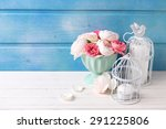 pastel roses in turquoise vase... | Shutterstock . vector #291225806