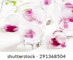 ice cubes with rose petals on... | Shutterstock . vector #291368504