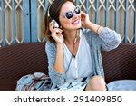 young pretty woman sitting in... | Shutterstock . vector #291409850