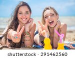 two girlfriends resting on the... | Shutterstock . vector #291462560