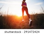 young woman running on a rural... | Shutterstock . vector #291472424