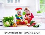 Kids Cooking Fresh Vegetable...