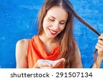 woman using dry shampoo on her... | Shutterstock . vector #291507134