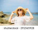 young girl in sunglasses and a... | Shutterstock . vector #291565928