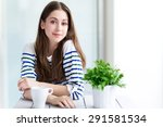 woman with a cup of coffee  | Shutterstock . vector #291581534