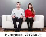 Stock photo shy woman and man sitting on sofa couch next each other first date attractive girl and handsome 291652679