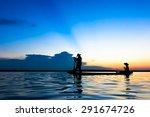 Fisherman action when fishing during sunset - stock photo