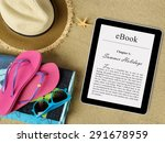ebook tablet on beach | Shutterstock . vector #291678959
