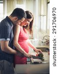 young couple cooking together... | Shutterstock . vector #291706970