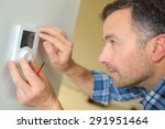 electrician fitting a... | Shutterstock . vector #291951464
