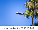 Small photo of MALAGA, SPAIN - JUNE 23: Ryan Air plane before landing at AGP Airport on June 23, 2015. Ryan air is an Irish low-cost airline.