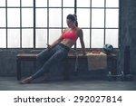 a fit  buff  muscular woman is... | Shutterstock . vector #292027814