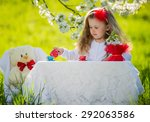 child in the garden drinking tea | Shutterstock . vector #292063586